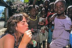 Jacqueline Points Blowing Bubbles For Children