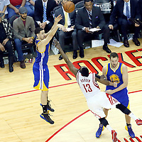 23 May 2015: Golden State Warriors guard Klay Thompson (11) takes a jump shot over Houston Rockets guard James Harden (13) on a screen set by Golden State Warriors forward David Lee (10) during the Golden State Warriors 115-80 victory over the Houston Rockets, in game 3 of the Western Conference finals, at the Toyota Center, Houston, Texas, USA.