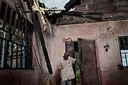 A man is entering his destroyed home in Kakuruk village, Gashish district, in the local government of Barkin Ladi, near Jos, Plateau State, Nigeria. The village, inhabited by Christians from the Berom tribe, has received various attacks by neighbouring Muslim Fulani - a nomadic cattle-herder tribe non-indigenous to Plateau - with the last one on 7th July, 2012, when more than 30 houses were demolished and 8 Christian villagers killed.