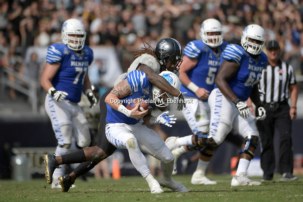Central Florida linebacker Shaquem Griffin (18) sacks Memphis quarterback Riley Ferguson (4) during the first half of the American Athletic Conference championship NCAA college football game Saturday, Dec. 2, 2017, in Orlando, Fla. (Photo by Phelan M. Ebenhack)