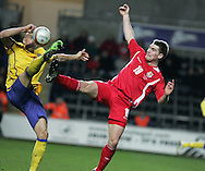 Daniel Majstorovic of Sweden (l) is challenged by Sam Vokes of Wales (r). International friendly, Wales v Sweden at the Liberty Stadium in Swansea on Wed 3rd March 2010. pic  by  Andrew Orchard
