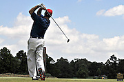 Golfer tees off on 8th hole Stanford St. Jude in Memphis.