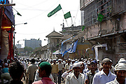 On the main road through Dharavi muslims return from friday afternoon prayers on 21st Oct 2006. An estimated 70% of Dharavi's population is muslim.