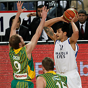 Anadolu Efes's Cenk Akyol (R) during their Turkish Basketball League match Anadolu Efes between Olin Edirne at Arena in Istanbul, Turkey, Saturday, February 11, 2012. Photo by TURKPIX