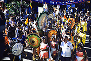 People dressed in colourful costumes for the carnival procession, Port of Spain, Trinidad 1963
