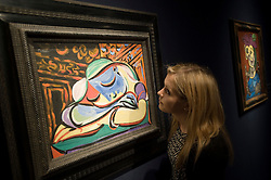 © licensed to London News Pictures. London, UK  17/06/2011. A Christies worker looks at  'Jeune fille endormie' by Pablo Picasso, which is estimated to fetch up to £12 million at auction as part of Christies upcoming auction of Impressionist and Modern Art. Please see special instructions for usage rates. Photo credit should read Ben Cawthra/LNP