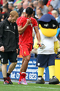 Liverpool's Emre Can walks off injured. pre-season friendly match, Preston North End v Liverpool at Deepdale in Preston, England on Saturday 19th July 2014.<br /> pic by Chris Stading, Andrew Orchard sports photography.
