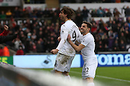 Fernando Llorente of Swansea city (l) celebrates with teammate Angel Rangel ®  after he scores his teams 3rd goal to make it 3-2.   Premier league match, Swansea city v Burnley at the Liberty Stadium in Swansea, South Wales on Saturday 4th March 2017.