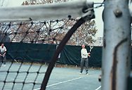 William McChesney Martin Jr, Chairman of the Board of Governors of the Federal Reserve System playing tennis on the tennis courts at the Federal Reserve headquarters in  November 1968.<br /> Photo by Dennis Brack bb72