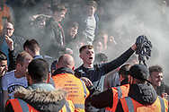 The fans celebrate as a smoke bomb goes off during the EFL Sky Bet League 1 match between Port Vale and Bolton Wanderers at Vale Park, Burslem, England on 22 April 2017. Photo by Mark P Doherty.