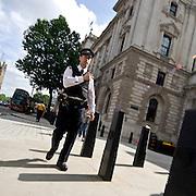 English Policeman walking along a London Street