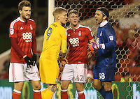 Nottingham Forest's goalkeeper Vladimir Stojkovic and Joe Worrall keep a close watch on Preston North End's Simon Makienok as they position themselves for a corner kick<br /> <br /> Photographer Stephen White/CameraSport<br /> <br /> The EFL Sky Bet Championship - Nottingham Forest v Preston North End - Wednesday 14th December 2016 - The City Ground - Nottingham<br /> <br /> World Copyright © 2016 CameraSport. All rights reserved. 43 Linden Ave. Countesthorpe. Leicester. England. LE8 5PG - Tel: +44 (0) 116 277 4147 - admin@camerasport.com - www.camerasport.com