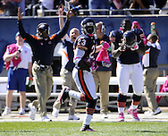 CHICAGO, IL-OCTOBER 2:  Devin Hester #23 of the Chicago Bears runs back a punt return for a touchdown during an NFL game against the Carolina Panthers on October 2, 2011 at Soldier Field in Chicago, Illinois.  Hester set a new NFL record for most kick returns for a touchdown at 11 on this return.  (Photo by Ron Vesely)