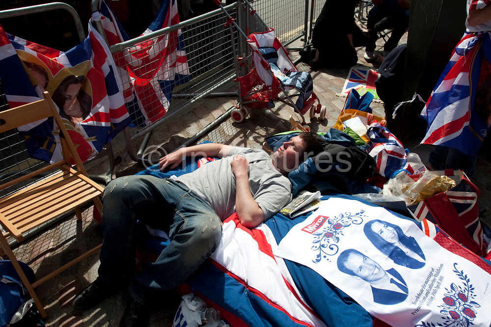 Preparations for the Royal Wedding as the first of the public start camping out on the parade route. Here opposite Westminster Abbey these patriotic royalists take their prime spot some three days before the wedding day itself.