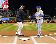 CLEVELAND, OH - OCTOBER 25: Managers Terry Francona #17 of the Cleveland Indians and Joe Maddon #70 of the Chicago Cubs shake hands before the start of Game 1 of the 2016 World Series at Progressive Field on Tuesday, October 25, 2016 in Cleveland, Ohio. (Photo by Ron Vesely/MLB Photos via Getty Images)