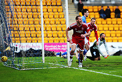 Aberdeen's Rooney cele scoring their first goal. <br /> half time : St Johnstone 0 v 2 Aberdeen, SPFL Ladbrokes Premiership played 6/2/2016 at McDiarmid Park, Perth.