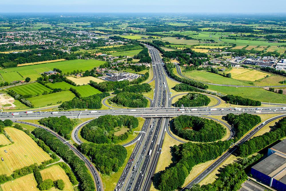 Nederland, Gelderland, Hoevelaken, 09-06-2016, knooppunt Hoevelaken, kruising Rijksweg A28 en de A1. Foto richting Hoevelaken . Bij het verkeersknooppunt is een file aan het ontstaan.<br /> The beginning of traffic jam at junction Hoevelaken.<br /> aerial photo (additional fee required);<br /> copyright foto/photo Siebe Swart