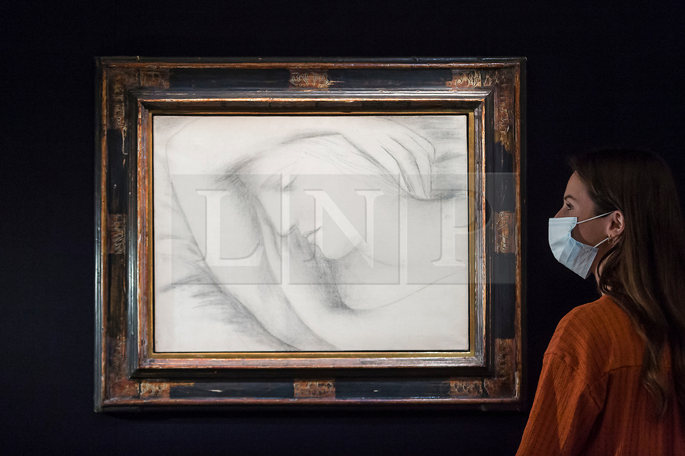 """© Licensed to London News Pictures. 23/07/2020. LONDON, UK. A staff member views """"Femme endormie (1931) by Pablo Picasso, estimate: £6-9 million. Preview of works on display at Sotheby's London ahead of a one-off auction on July 28.  Titled 'Rembrandt to Richter', the sale will offer the very best from Old Masters, Impressionist & Modern Art, Modern & Post-War British Art and Contemporary Art.  The exhibition is open to the public at Sotheby's New Bond Street galleries until July 28. [Image embargoed for release until 9am BST 24 July 2020].  Photo credit: Stephen Chung/LNP"""