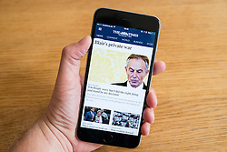 The Times electronic newspaper app on a iPhone 6 smartphone showing Tony Blair story