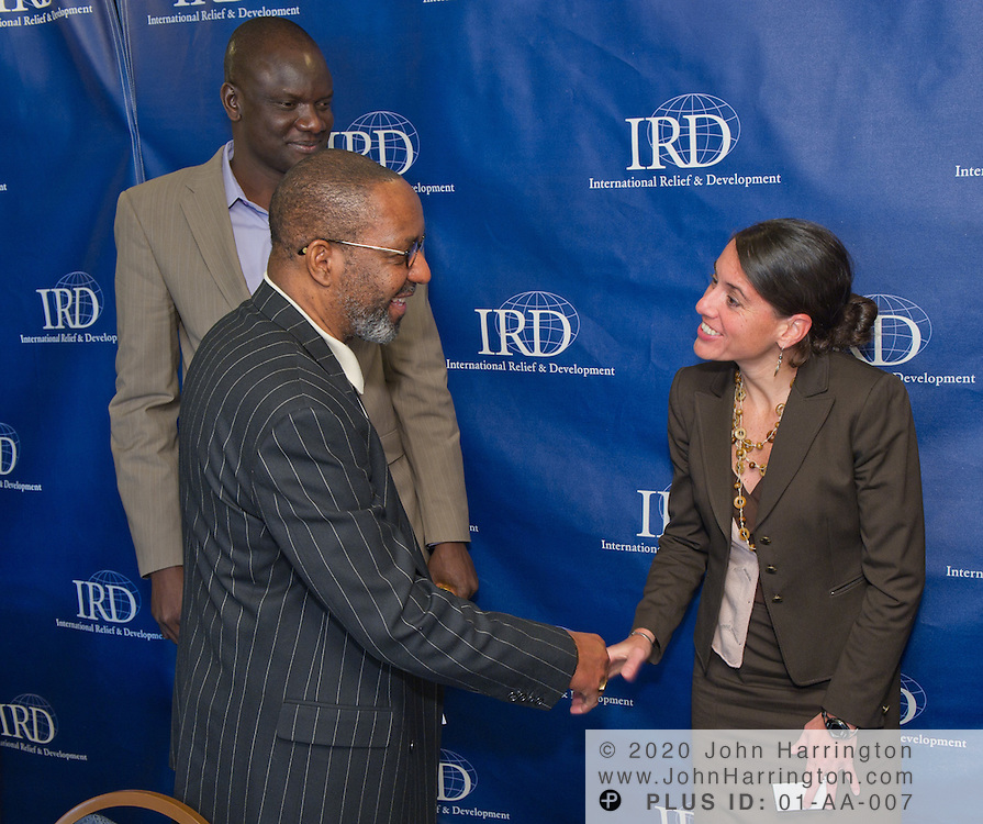 """Andrea Freeman, Program Analyst with USAID's Office of Sudan Programs, shakes hands with radio journalist Kojo Nnamdi after a panel discussion featuring Nnamdi as moderator, John Dau, a former Southern Sudanese """"Lost Boy"""" and human rights activist, Enrico Carisch, former UN sanctions monitor in Sudan, Richard Owens, Director of Community Stabilization at IRD, and Freeman at the National Press Club in Arlington, VA on December 9th, 2010. The panel discussed the impact of the possible secession of Southern Sudan from Sudan on the future of the African region."""
