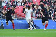 England's Marcus Rashford taking on Croatia's Dejan Lovren and Croatia's Tin Jedvaj during the UEFA Nations League match between England and Croatia at Wembley Stadium, London, England on 18 November 2018.