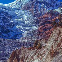 An icefall tumbles down from glaciers on the Annapurna massif, above Manang, Nepal.
