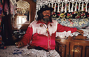 The Manouche family of Pepe LaFleur, who had more than 70 grand children, he was king of his clan. A devout pilgrim, charismatic character ever present at Saintes Maries de la Mer for the Gypsy Festival for decades. Pepe LaFleur always well dressed with flashy shirts, hats and heavy gold jewelery, living all year round in a beautiful and traditional wooden wagon a 'roulotte' with effigies of Saint Sara and lace curtains. He always carried the Manouche Gypsy Standard 'Le pelerinage des Gitans' to the sea with his cousins<br /><br />Europe, France, Camargue, Saintes Maries de la Mer. The Gypsies, pilgrims and participants of the festival at Saintes Maries. The Gypsy festuval attracts many well known characters, both visiting Gypsies and locals all dressed up for the occasion. Everyone loves to dress up and are proud of their traditions and culture.