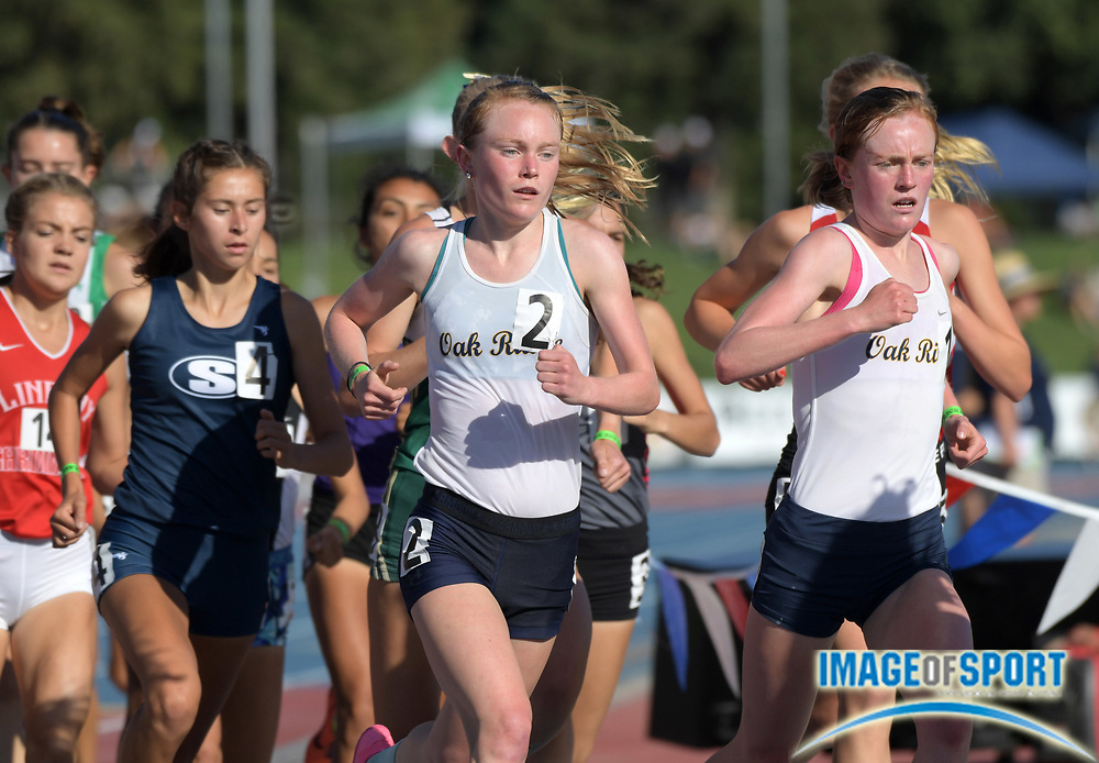 Jun 1, 2018; Clovis, CA, USA; Twin sisters Maddy Denner (1) and Elena Denner (2) of Oak Ridge lead a girls 1,600m heat during the 110th CIF State Championships at Veterans Memorial Stadium.