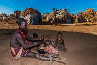 Dassanach tribe woman with her children, Omo Valley, Ethiopia.