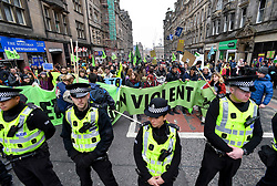 Pictured: protesters blockaded both ends of North Bridge bringing traffic to a standstill.<br /> <br /> Extinction Rebellion Scotland hosted a demo in which protestors were encouraged to block traffic on North Bridge, Edinburgh, in a bid to highlight the climate change issue, as part of a co-ordinated nationwide action.<br /> <br /> © Dave Johnston/ EEm