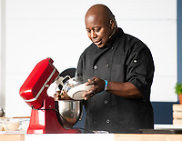 RALPH ROLLE drummer from Chic in the big kitchin  making cookies  and and playing the drums at the Big Feastival 2021 on Alex James Cotswolds farm, Kingham oxfordshire