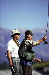 Famous test pilot Chuck Yeager fishes the Snake River in Jackson Hole Wyoming as guide Mike Lawson looks on.
