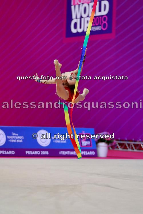 Tuncel Kamelya during qualifying at ribbon in Pesaro World Cup 14 April, 2018. Kamelya is a turkish gymnast born in Yenimahalle, metropolitan district of Ankara Province, in 2002.