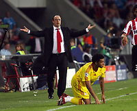 Photo: Chris Ratcliffe.<br /> PSV Eindhoven v Liverpool. UEFA Champions League, Group C. 12/09/2006.<br /> Rafael Benitez of Liverpool is exasperated as Jermaine Pennant is floored.