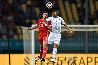 """Luis Suarez, top, of Uruguay national football team heads the ball to make a pass against James Chester of Wales national football team in their final match during the 2018 Gree China Cup International Football Championship in Nanning city, south China's Guangxi Zhuang Autonomous Region, 26 March 2018.<br /> <br /> Edinson Cavani's goal in the second half helped Uruguay beat Wales to claim the title of the second edition of China Cup International Football Championship here on Monday (26 March 2018). """"It was a tough match. I'm very satisfied with the result and I think that we can even get better if we didn't suffer from jet lag or injuries. I think the result was very satisfactory,"""" said Uruguay coach Oscar Tabarez. Wales were buoyed by a 6-0 victory over China while Uruguay were fresh from a 2-0 win over the Czech Republic. Uruguay almost took a dream start just 3 minutes into the game as Luis Suarez's shot on Nahitan Nandez cross smacked the upright. Uruguay were dealt a blow on 8 minutes when Jose Gimenez was injured in a challenge and was replaced by Sebastian Coates. Inter Milan's midfielder Matias Vecino of Uruguay also fired at the edge of box from a looped pass but only saw his attempt whistle past the post. Suarez squandered a golden opportunity on 32 minutes when Ashley Williams's wayward backpass sent him clear, but the Barca hitman rattled the woodwork again with goalkeeper Wayne Hennessey well beaten."""