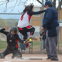 Grants Pirate Angelica Nanez (6) is tagged out at home plate by Albuquerque Charger Angelina Grine (18) Tuesday in Grants.