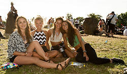 © Licensed to London News Pictures. 25/06/2015. Pilton, UK. A group of festival goers at the Stone Circle at Glastonbury Festival 2015 on Thursday Day 2 of the festival.  This years headline acts include Kanye West, The Who and Florence and the Machine, the latter having been upgraded in the bill to replace original headline act Foo Fighters.   Photo credit: Richard Isaac/LNP