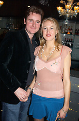 MR HARRY & LADY PORTIA BAKER at a party to celebrate the birthdays of Camilla Hacking, Micki Hacking and Colin Fitzgerald held at The Baglioni Hotel, 60 Hyde Park Gate, London SW7 on 22nd January 2005.<br /><br />NON EXCLUSIVE - WORLD RIGHTS