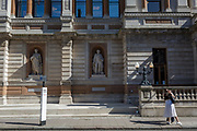 With a further 184 reported UK Covid deaths in the last 24 hrs, a total now of 43,414, old friends ignore lockdown rules when greeting each other with a hug infront of the statues of Gottfried Leibniz, Georges Cuvier and Carl Linnaeus, and alongside a social distance post outside the Royal Academy on Burlington Gardens, on 26th June 2020, in London, England. Government restrictions have yet to ease when the 2 metre rule is to be realxed on 4th July for 'one metre plus' and when art galleries like the RA re-open. Venues re-opening will be conditional on the progression of the virus and how well social distancing measures are implemented.