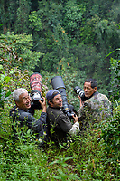 Chinese and international team, Mr Xie, Magnus Lundgren, Mr Tao, photographing gibbons in Wuliangshan Nature Reserve, Mount Wuliang Nature Reserve in Jingdong county, Yunnan, China.