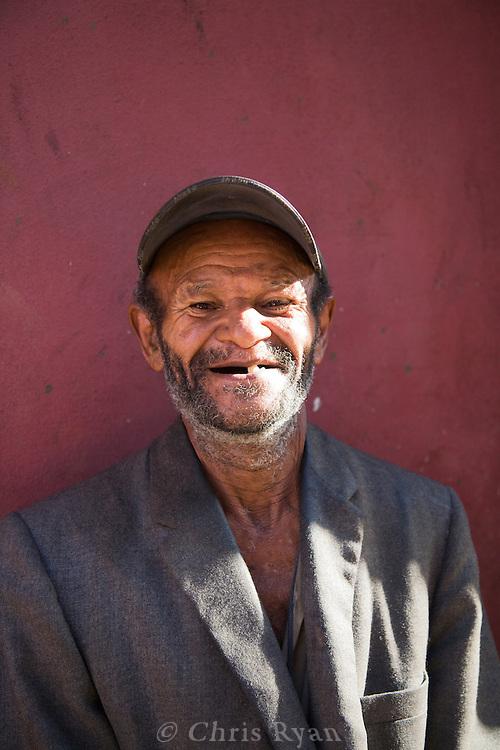 Elderly man outside Mercado Agropecuario Cuatros Caminos, Havana, Cuba