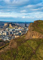 View of city of Edinburgh over Salisbury Crags from Arthur's Seat , Edinburgh, Scotland, UK.