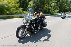 """Michael """"MJ"""" Jones riding back to Baltimore with his club the Flying Eagles MC (founded 1950). Baltimore, MD, USA. August 15, 2015.  Photography ©2015 Michael Lichter."""