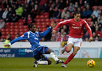 Photo: Glyn Thomas.<br />Nottingham Forest v Oldham Athletic. Coca Cola League 1.<br />14/01/2006.<br />Oldham's Anthony Grant (L) slides in to tackle Nathan Tyson.