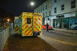 © Licensed to London News Pictures. 05/12/2019. London , UK. An ambulance parked on Clarence Road close to the scene of a fatal stabbing in Clarence Mews, Hackney. Police were called at 14:01 GMT and attended alongside London Ambulance Service and London's Air Ambulance where they found a man seriously injured. Despite their best efforts the man - believed to be aged in his 20s - was pronounced dead at the scene at 14:33hrs. Photo credit: Peter Manning/LNP