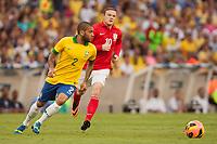 Football - International Friendly - Brazil vs. England<br /> Wayne Rooney of England chases Daniel Alves da Silva of Brazil at the Maracana Stadium, Rio de Janeiro