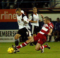 Photo. Catrine Gapper. Luton v Doncaster Rovers. Coca-Cola League One. 27/11/2004.<br /> Simon Marples (Doncaster) moves in to tackle Rowan Vine (Luton).