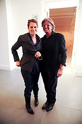 TRACEY EMIN and RICHARD CARING at the BRIC art sale preview (Brazil, Russia, India & China, the acronym BRIC here refers to the burgeoning contemporary art practices within these four countries.) organised by Phillips de Pury & Company at The Saatchi Gallery, London on 17th April 2010.