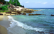Beach at Bel Ombre, southern  Mahe, Seychelles showing excavation site looking for pirate treasure.