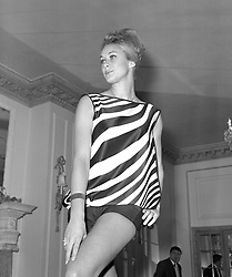 Aldine Honey models a striped top over a black bikini, one of the Sportaville creations for summer 1962.